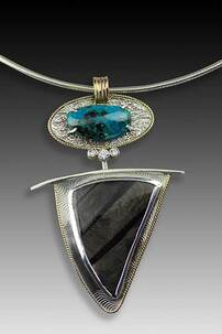 Two-way pendant in silver and 14k gold by Janet Alexander